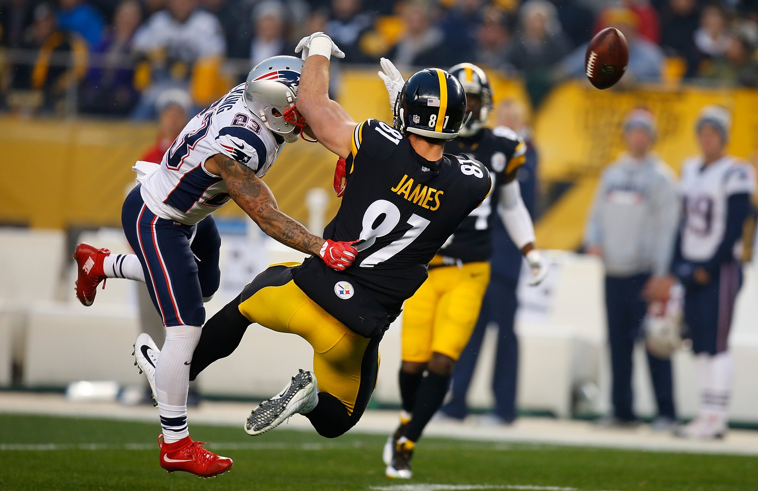 Patrick Chung of the New England Patriots, left, with the Pittsburgh Steelers' Jesse James at Heinz Field, Pittsburgh, Pennsylvania, December 17.