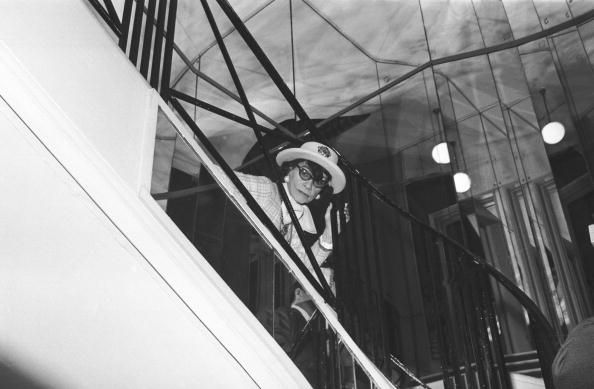 59851a351cf Coco CHANEL watches her fashion show from the staircase. Getty Images