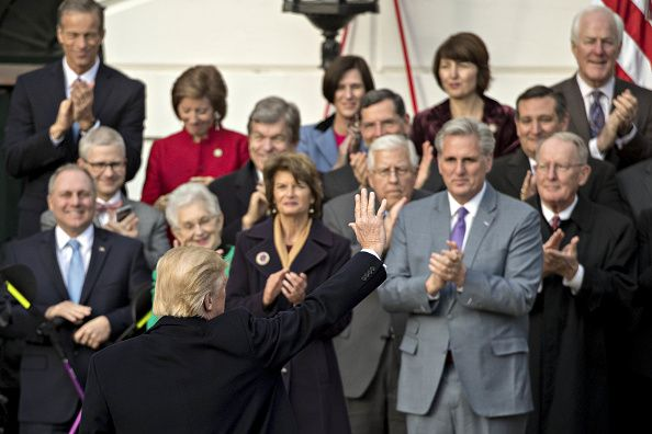 U S President Donald Trump Bottom Left Waves While Arriving To Speak During A Tax Bill Page Event With Republican Congressional Members Of The House