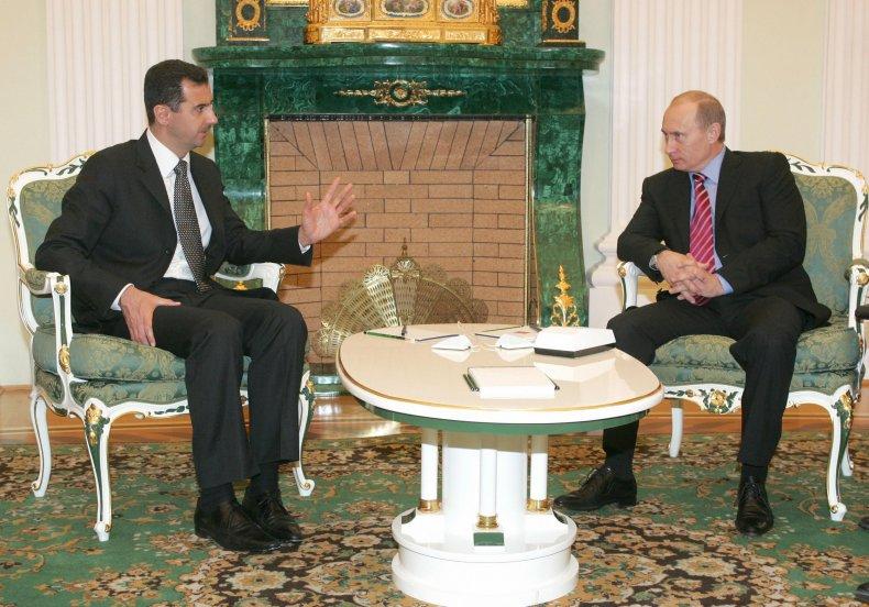 12_21_Putin_Assad