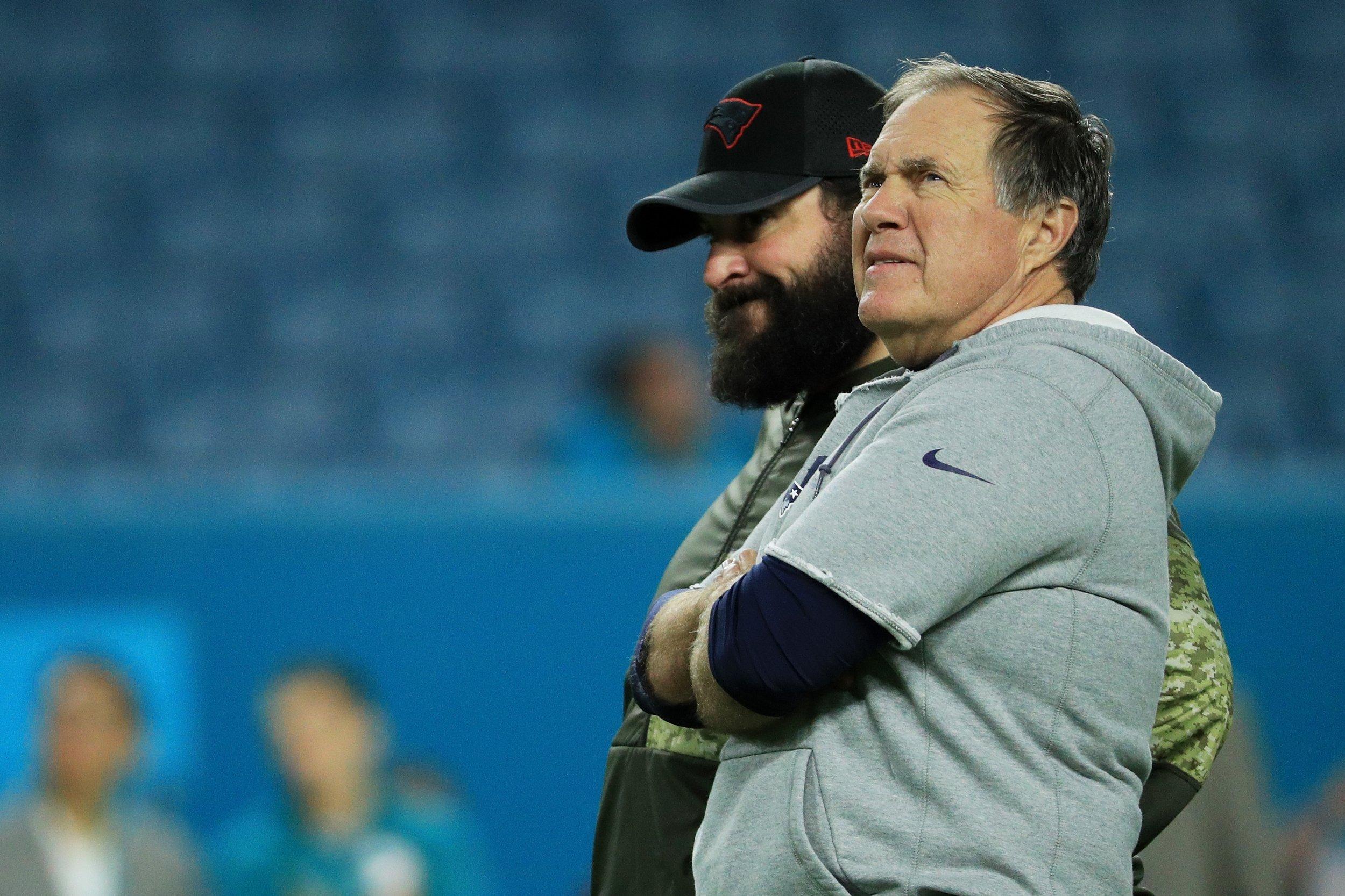 New England Patriots head coach Bill Belichick, front right, with defensive coordinator Matt Patricia.