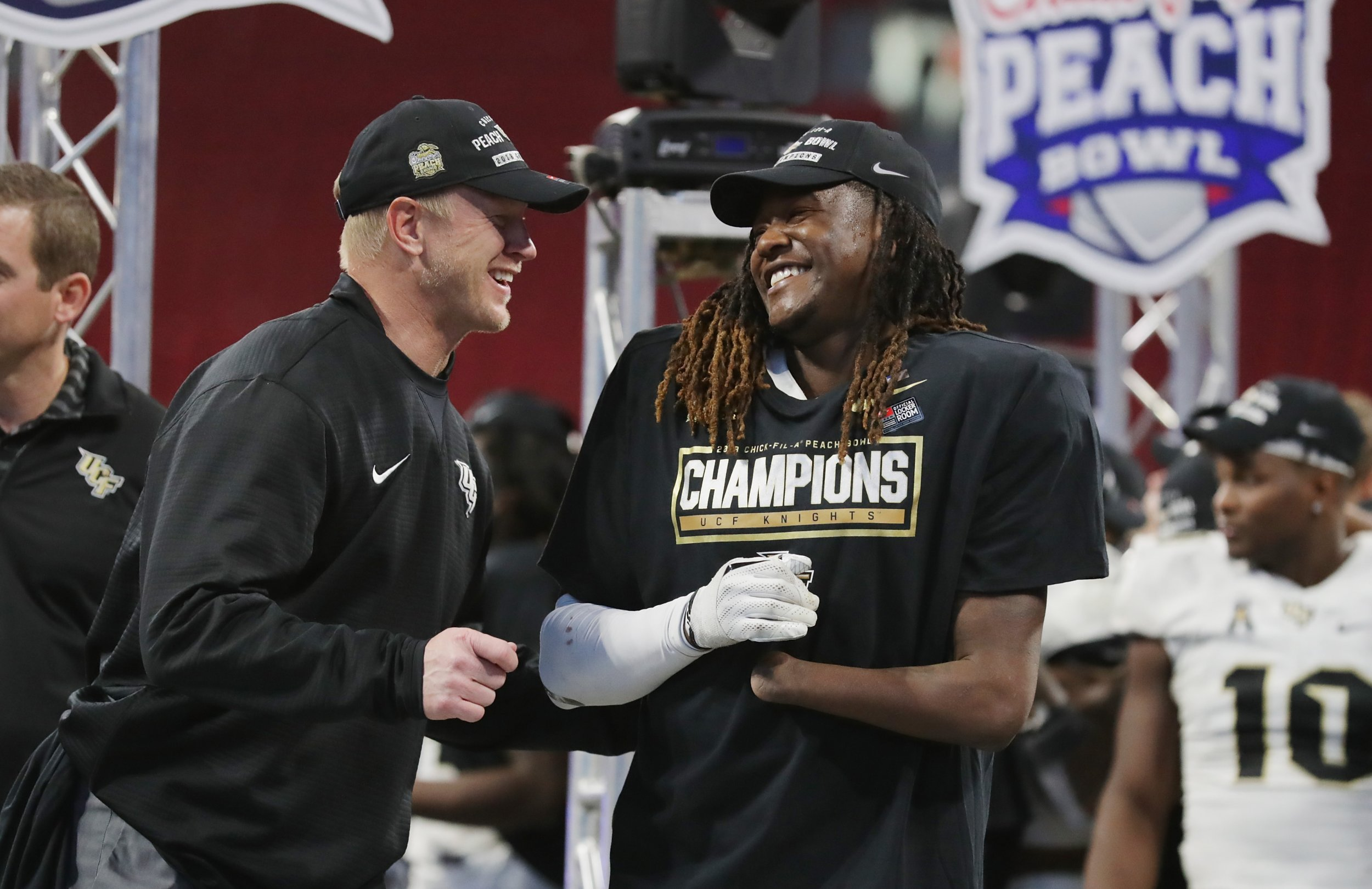Head coach Scott Frost, left, of the UCF Knights celebrates with Shaquem Griffin at Mercedes-Benz Stadium, Atlanta, January 1.
