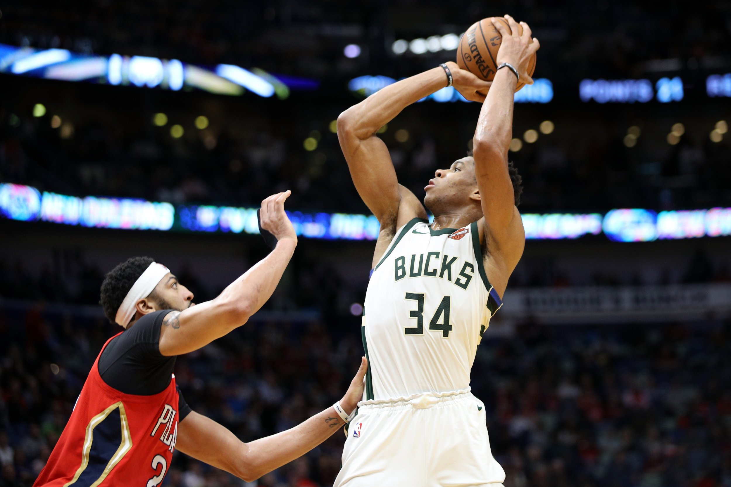 Giannis Antetokounmpo of the Milwaukee Bucks shoots the ball over Anthony Davis at Smoothie King Center, New Orleans, Louisiana, December 13 2017.