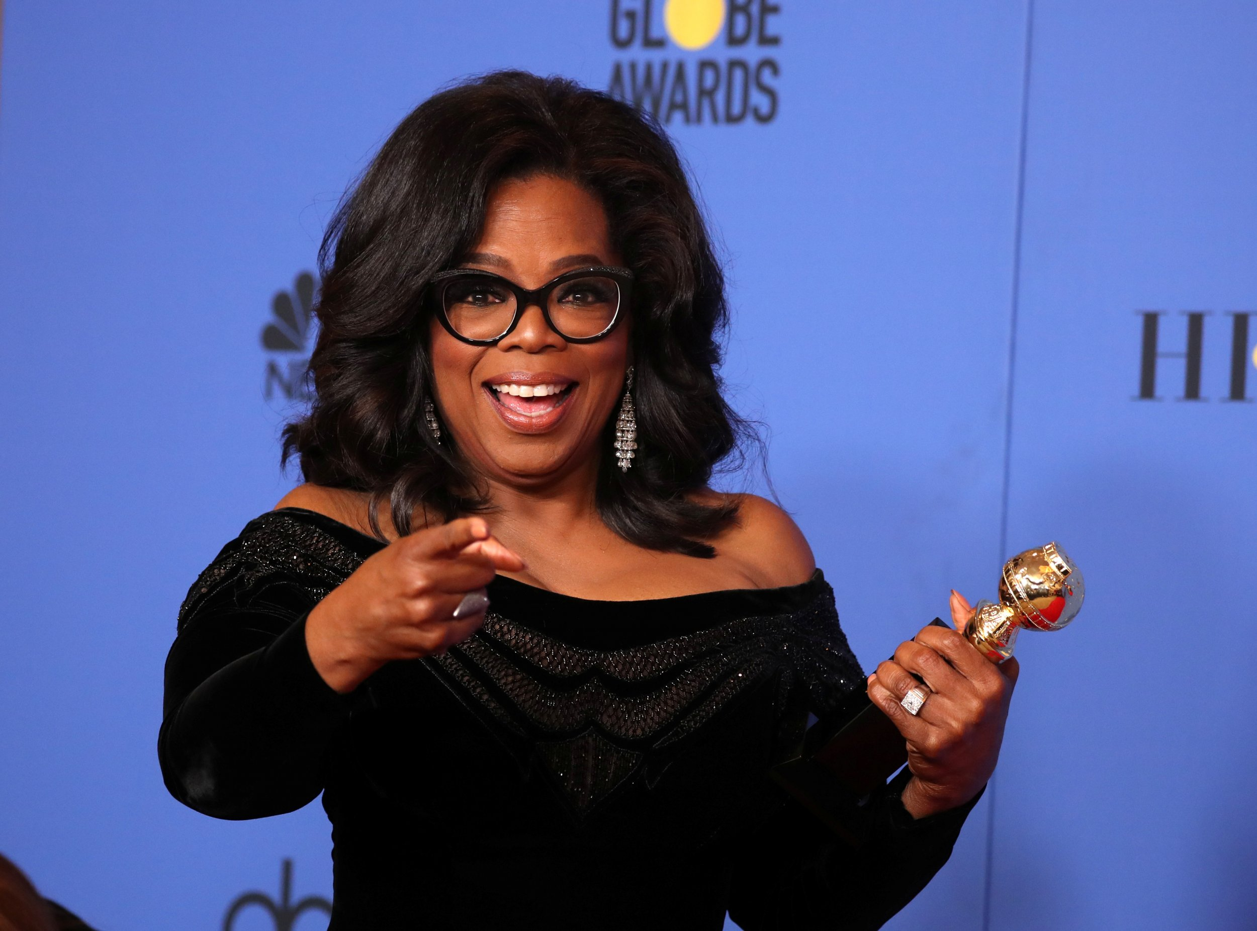 b193235ad17 Oprah Winfrey poses backstage with her Cecil B. DeMille Award at the 75th Golden  Globes in Beverly Hills