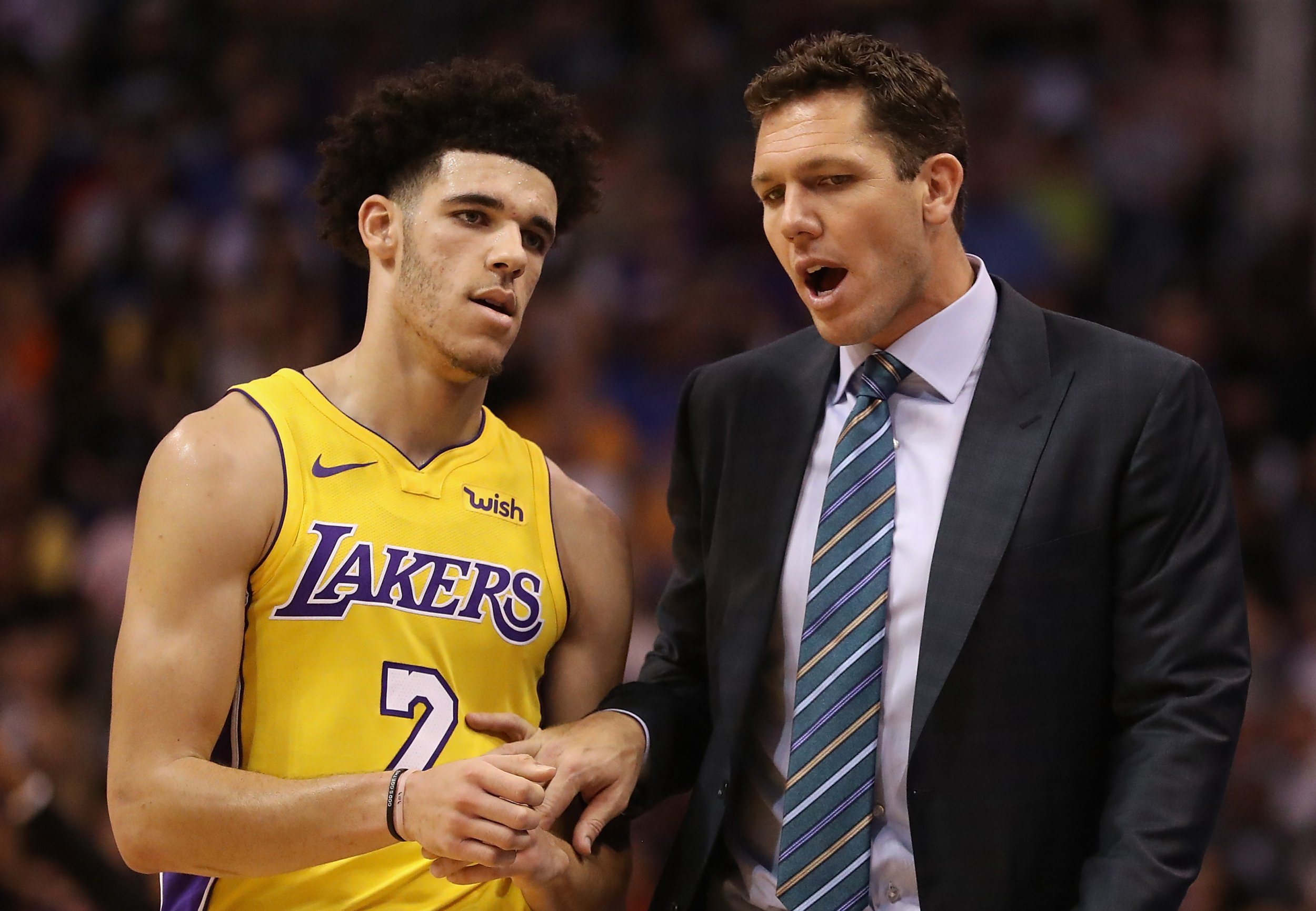 Lonzo Ball, left, with Lakers coach Luke Walton.