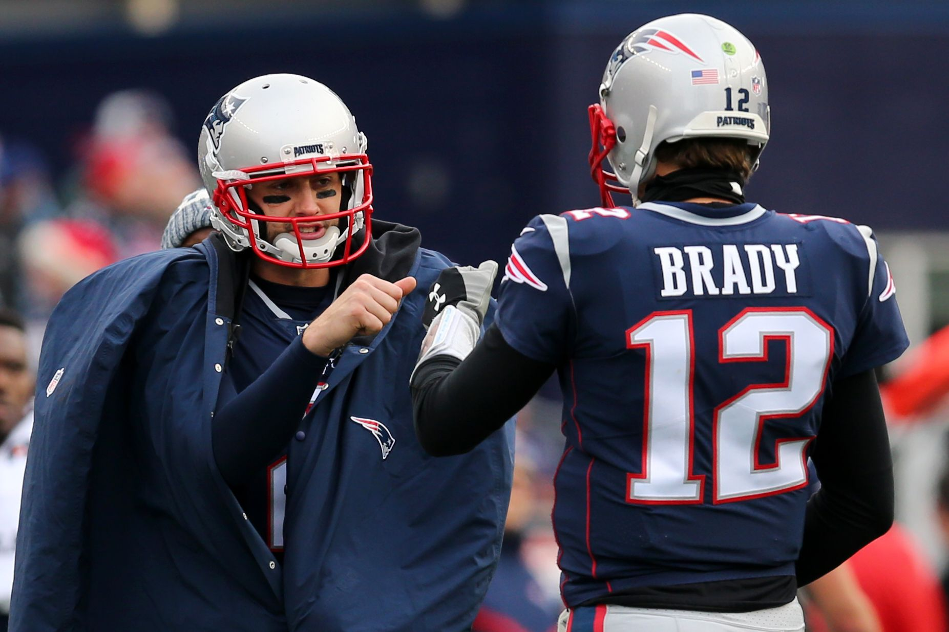 Brian Hoyer, left, with Tom Brady.