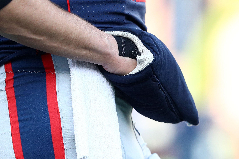 The right hand of Patriots quarterback Tom Brady.