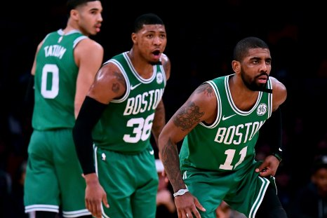 Jayson Tatum, left, Marcus Smart, center, and Kyrie Irving of the Boston Celtics.