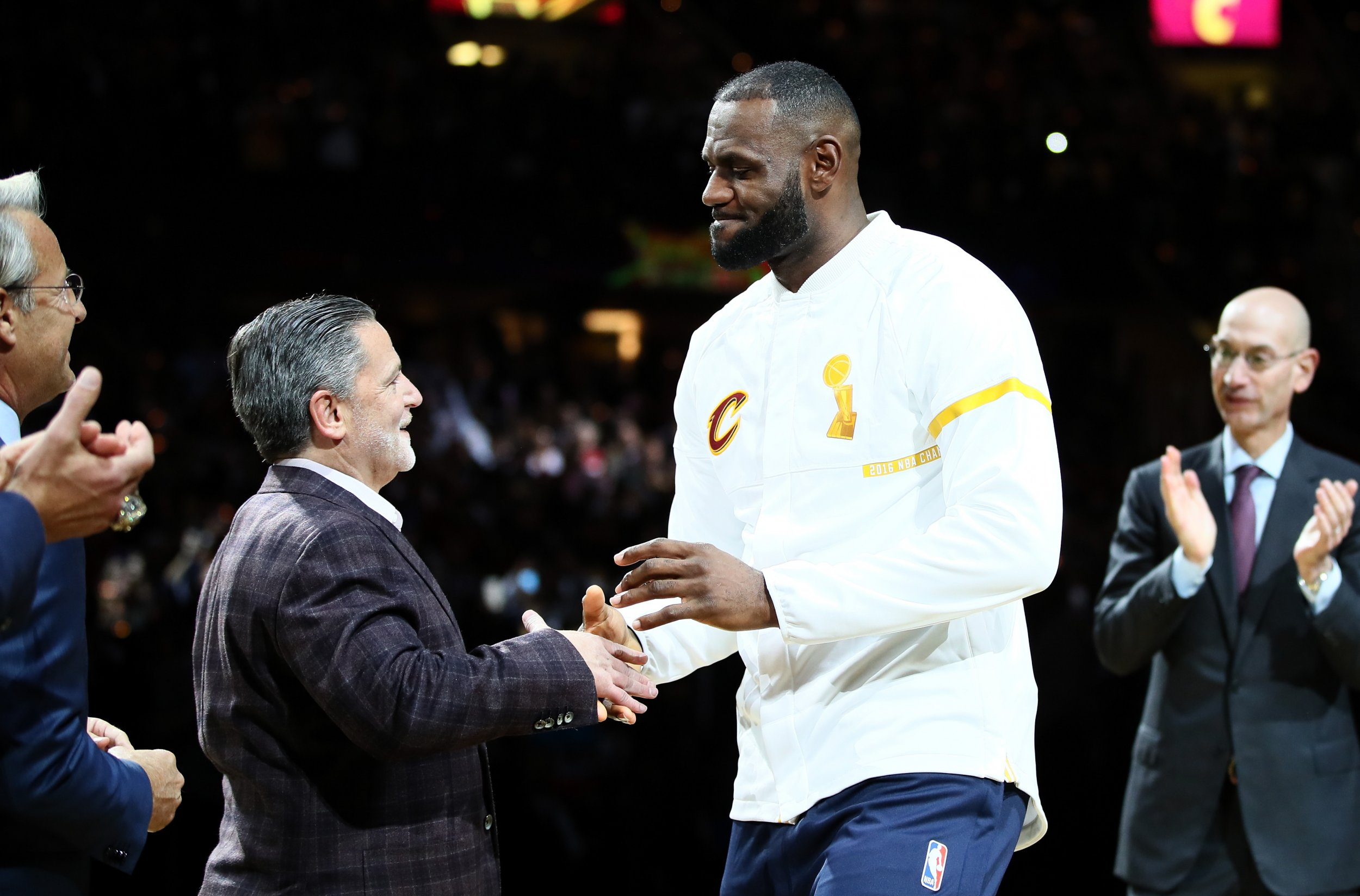 Cleveland Cavaliers owner Dan Gilbert, left.
