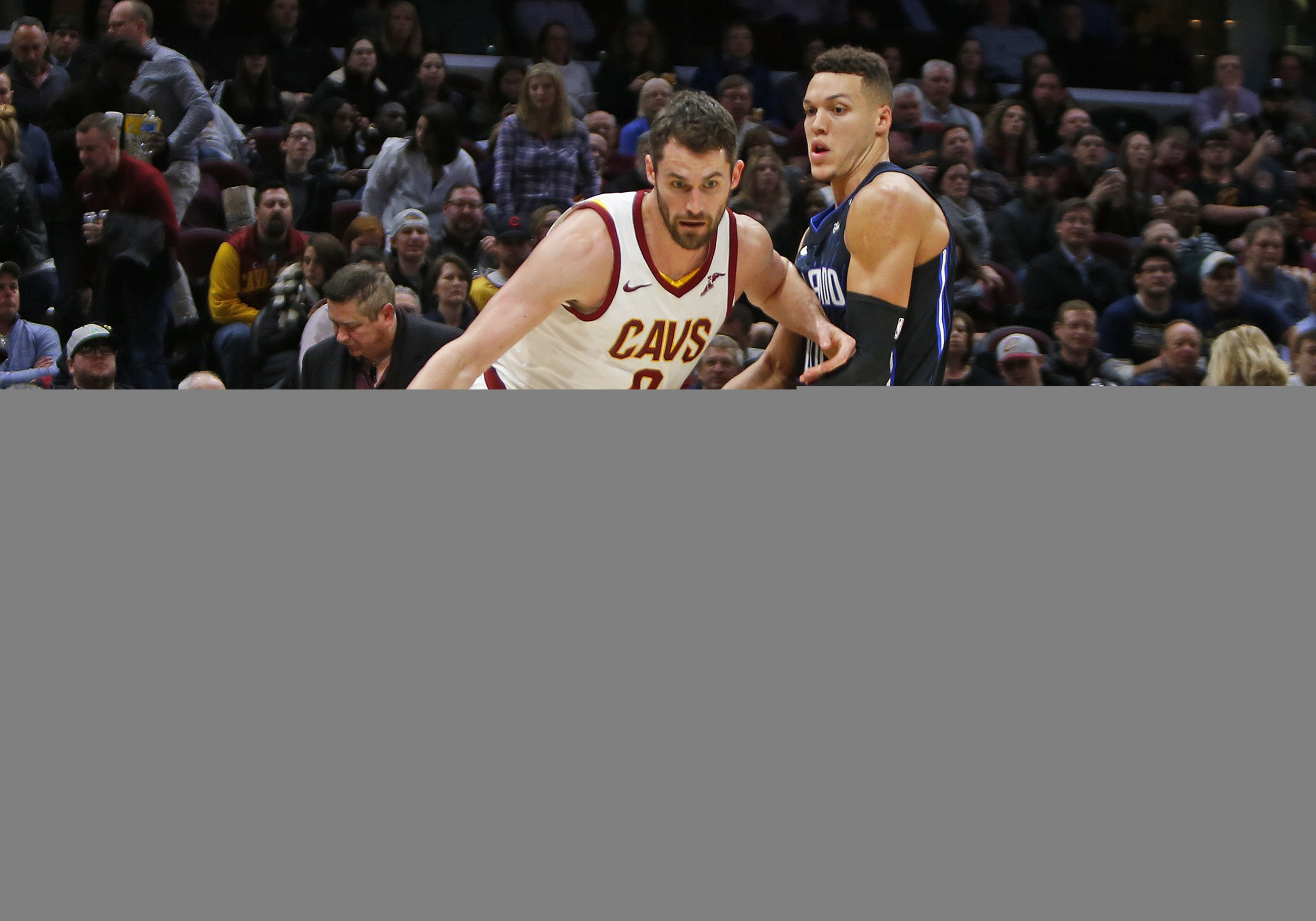 Cleveland Cavaliers forward Kevin Love, left.