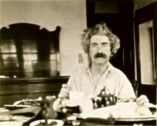 Mark_Twain_at_breakfast,_1895