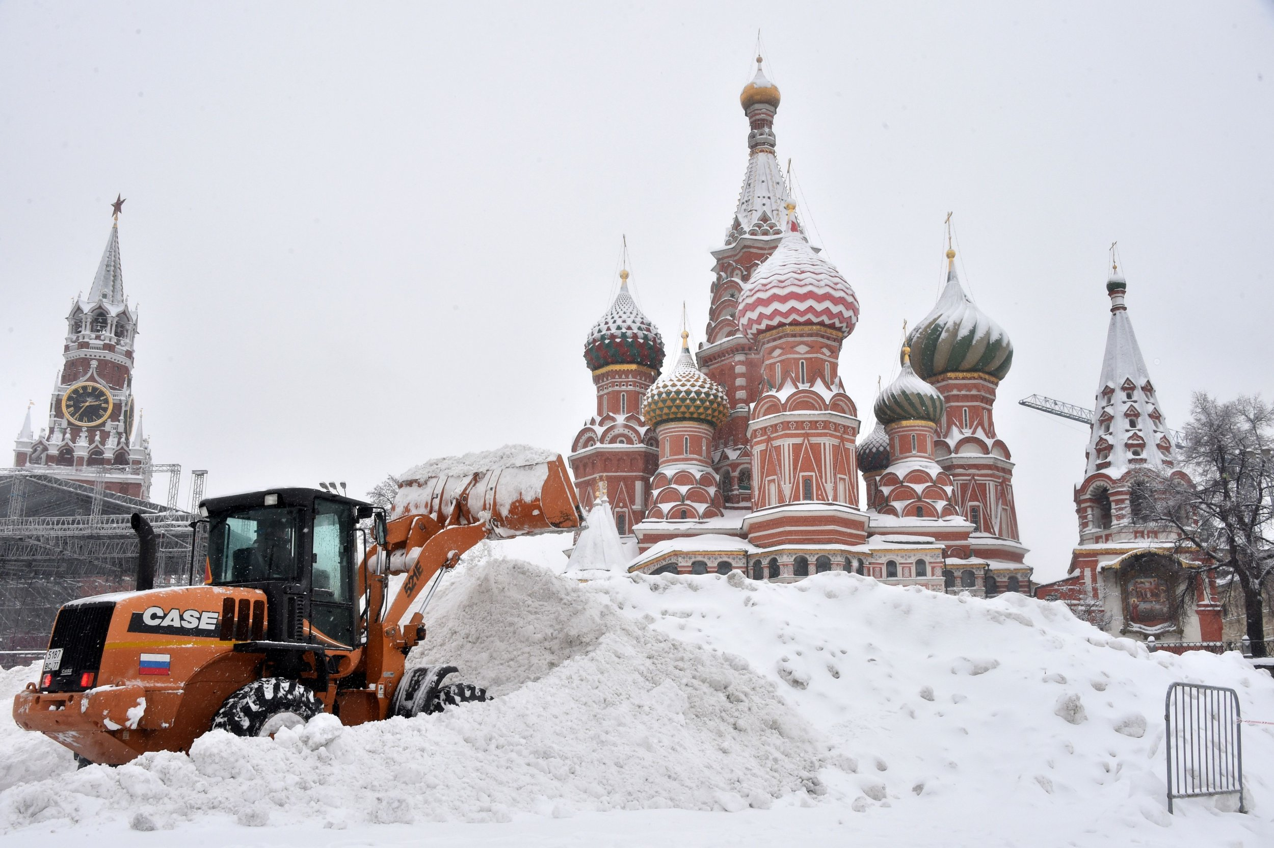 Pictures: Freak Snowstorm in Russia Buries Buildings, Leaves Tens of  Thousands Without Power