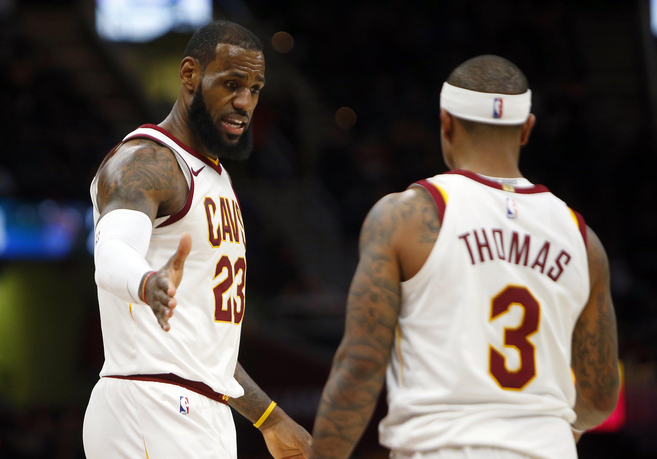 LeBron James, left, with Isaiah Thomas.