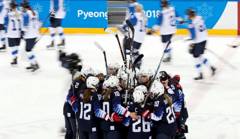 US women's ice hockey team celebrate victory over Finland
