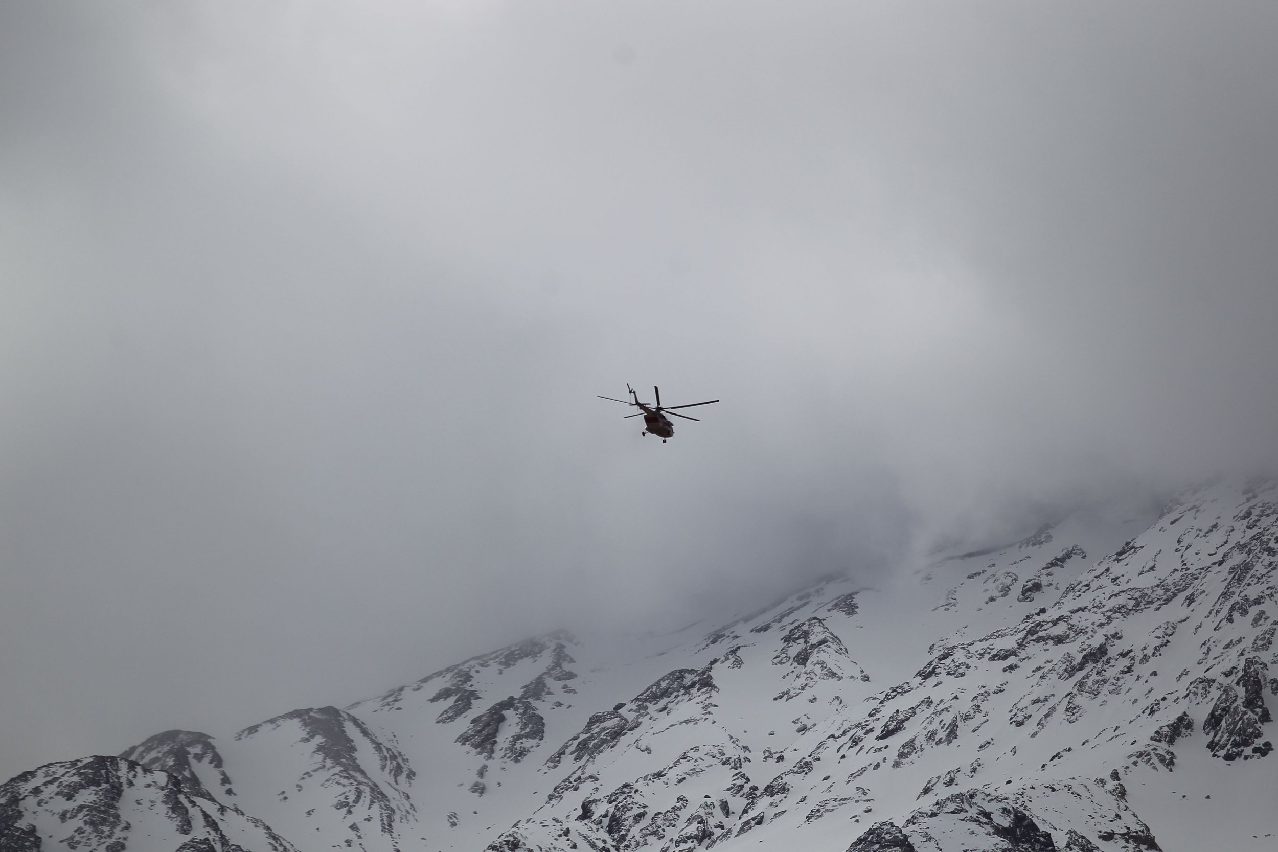 Iranian helicopter searches for missing plane over mountains