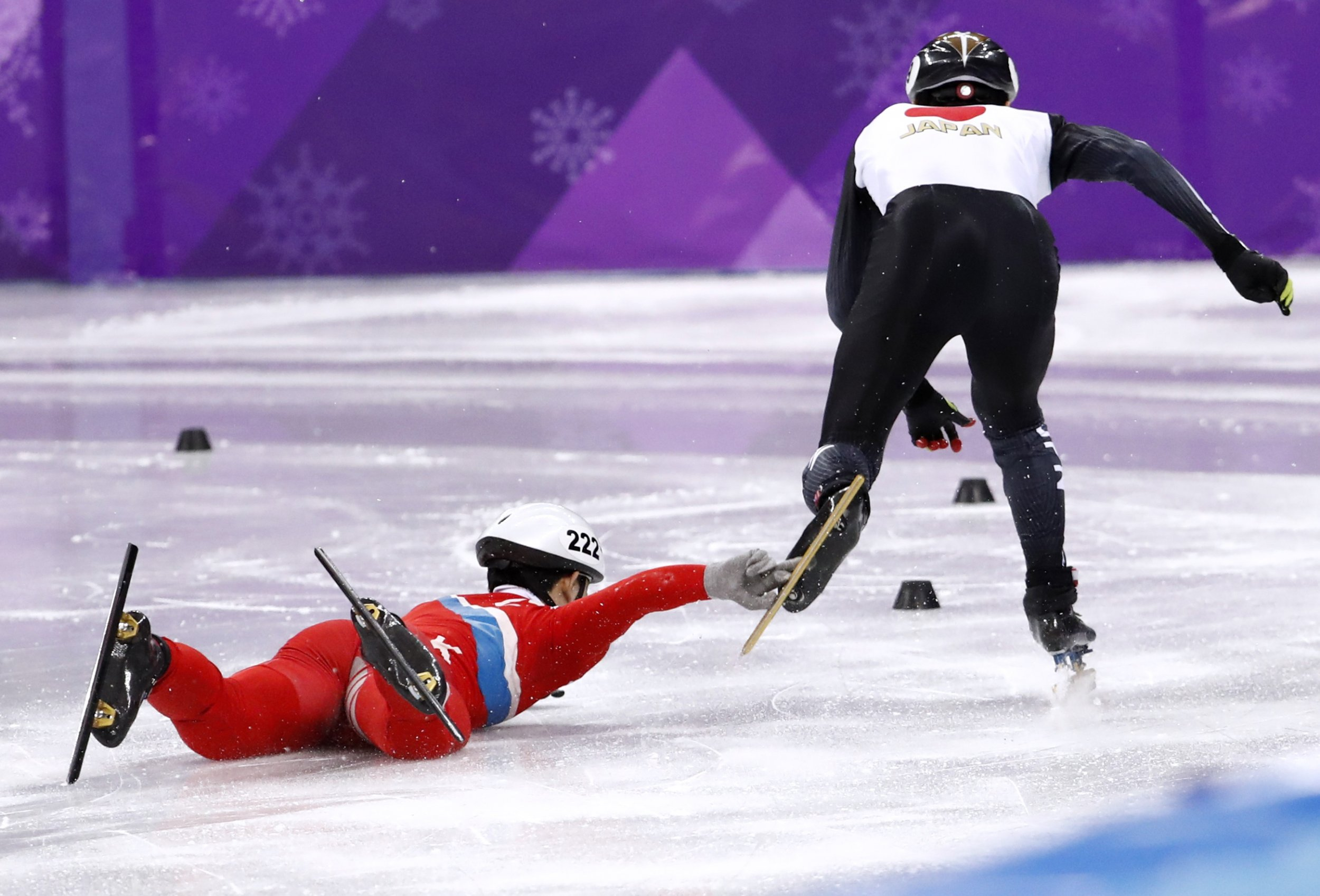 North Korean Speed Skater Tries to Take Down His Japanese Rival