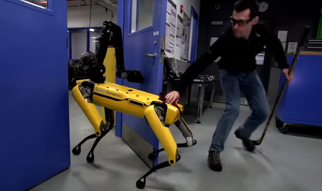 SpotMini robot learns to open door, battle humans