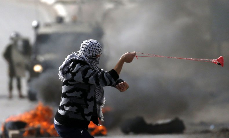 Palestinian man with slingshot in protests against Israeli forces in the West Bank