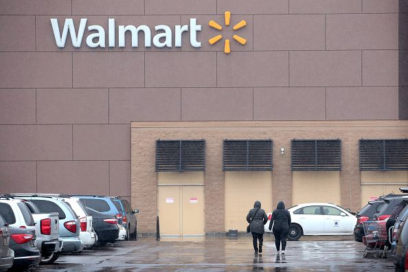 customers shop at walmart store on january 11 2018 in chicago illinois walmart home depot sears and many other stores will remain open for easter
