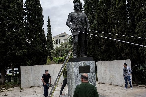 Greek communists tried to topple a Harry Truman statue in protest against U.S. airstrikes in Syria