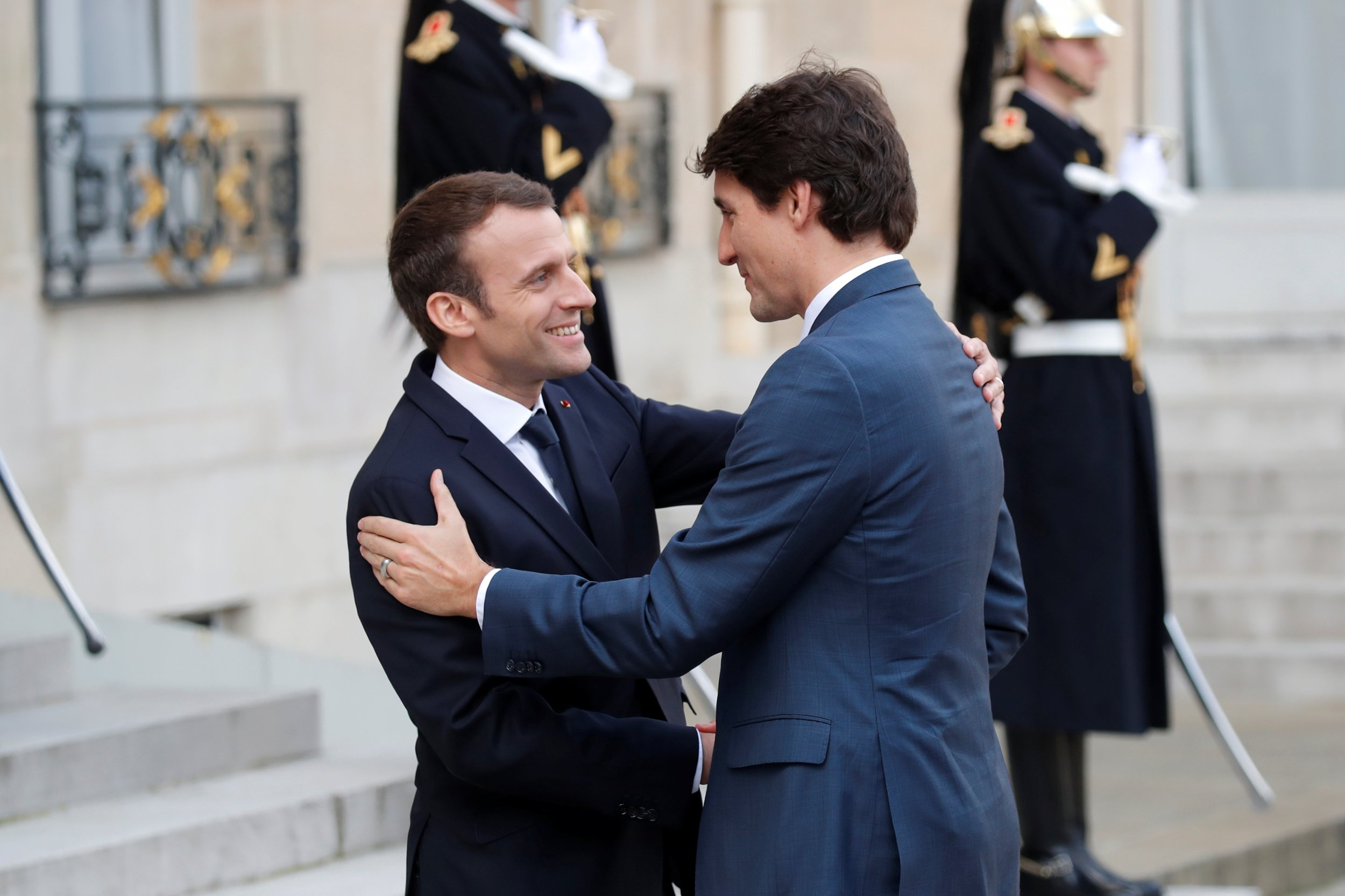 Image result for trudeau and macron greet