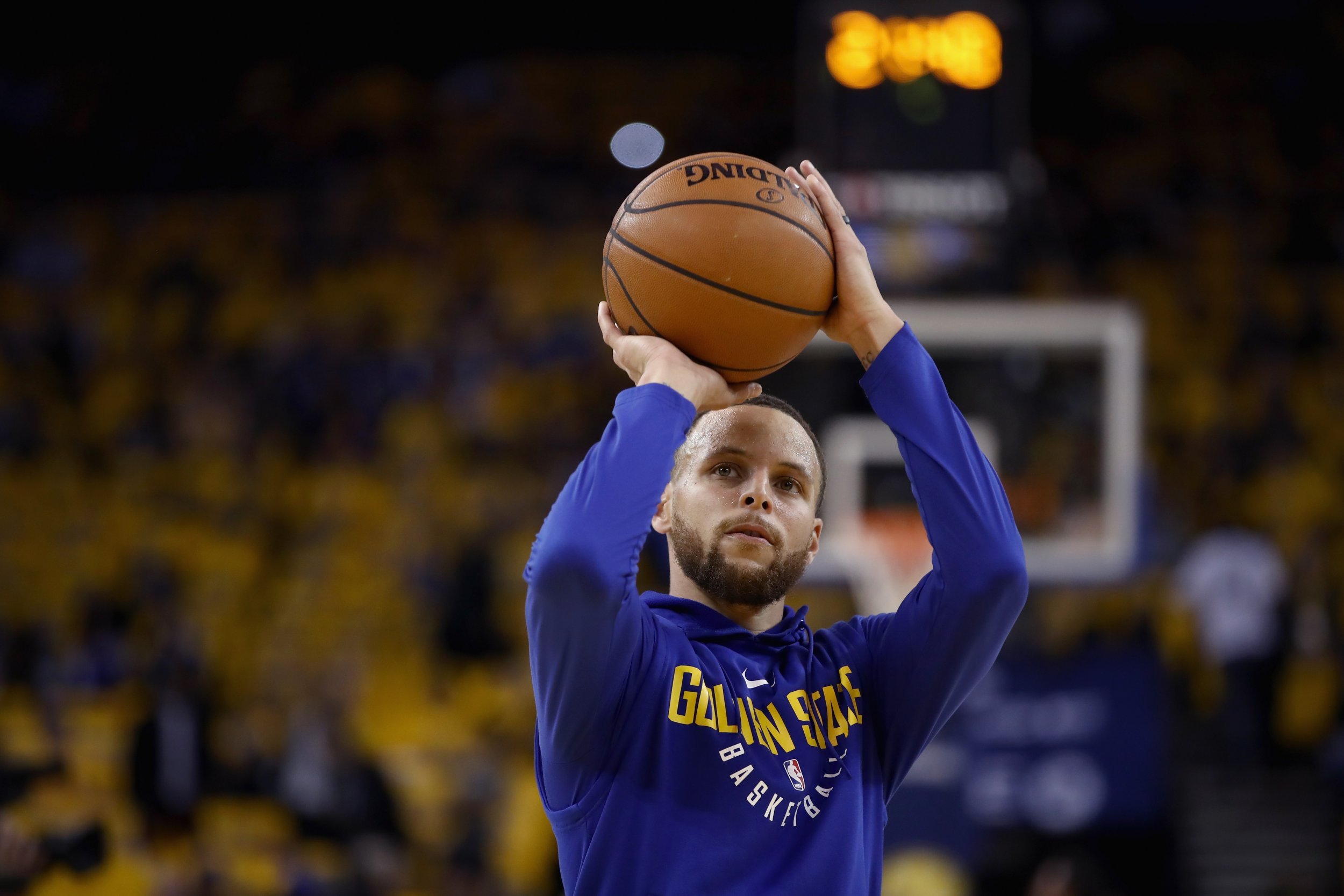 0af72701c8cd Stephen Curry of the Golden State Warriors warms up before their game  against the San Antonio Spurs during Game Five of Round One of the 2018 NBA  Playoffs ...
