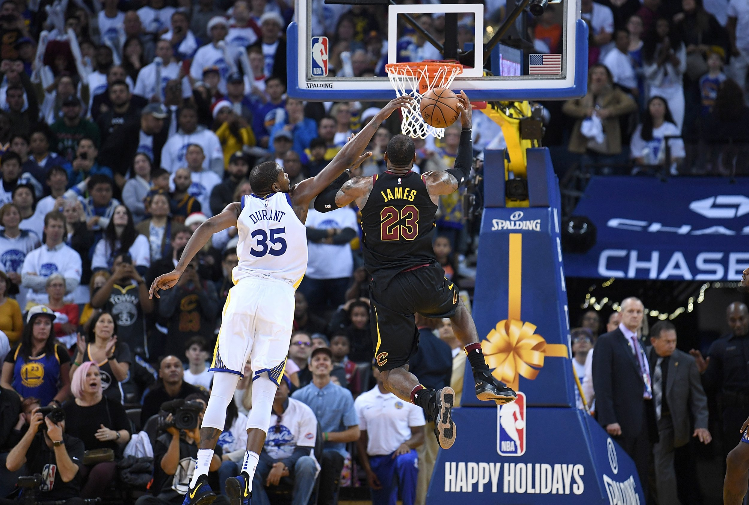 b333b246e Kevin Durant of the Golden State Warriors defends the shot of LeBron James  of the Cleveland Cavaliers late in the fourth quarter of an NBA basketball  game ...