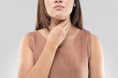 woman-throat-pain-neck-stock