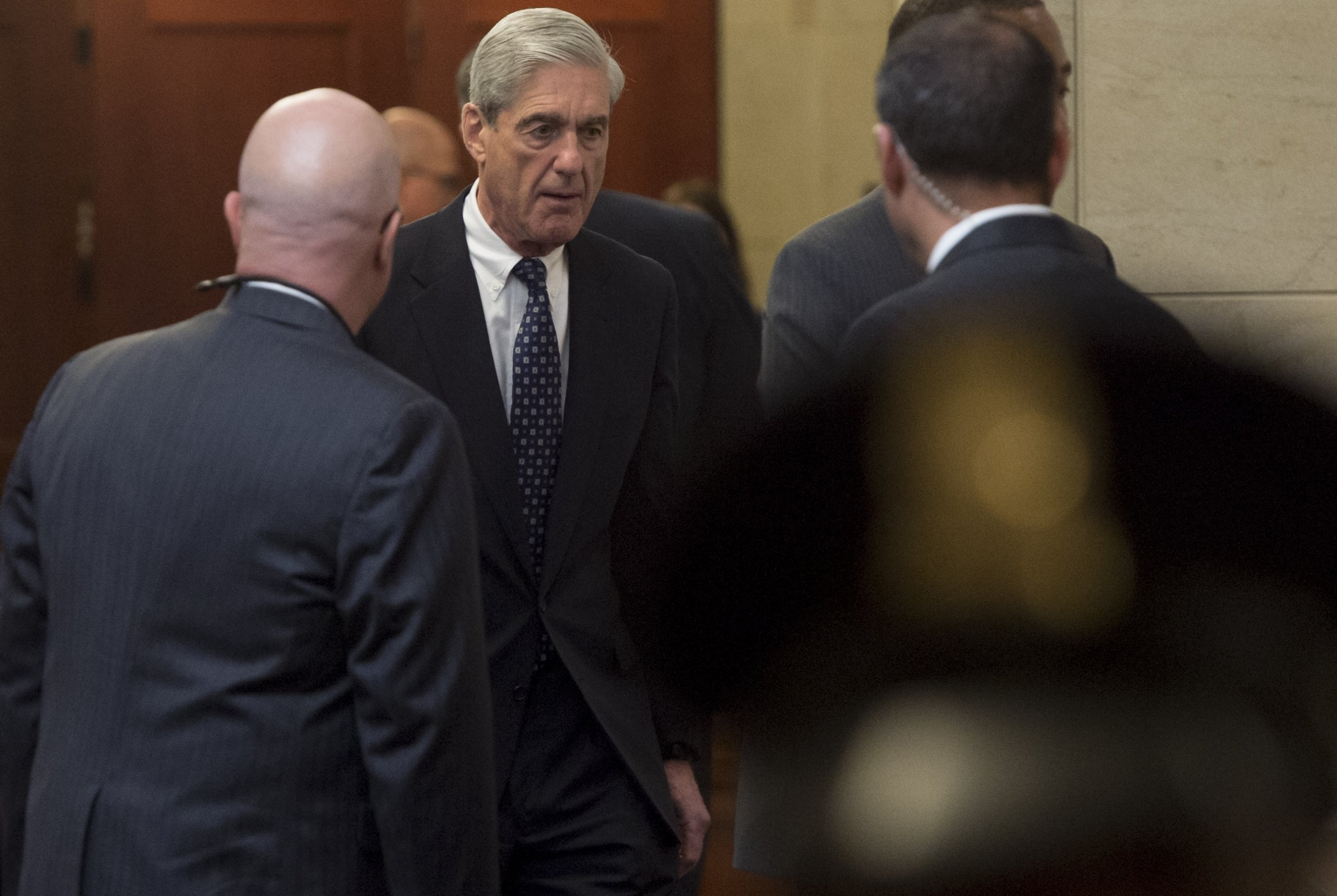 Robert Mueller has lost support from Democrats and independents amid Trump attacks, poll suggests
