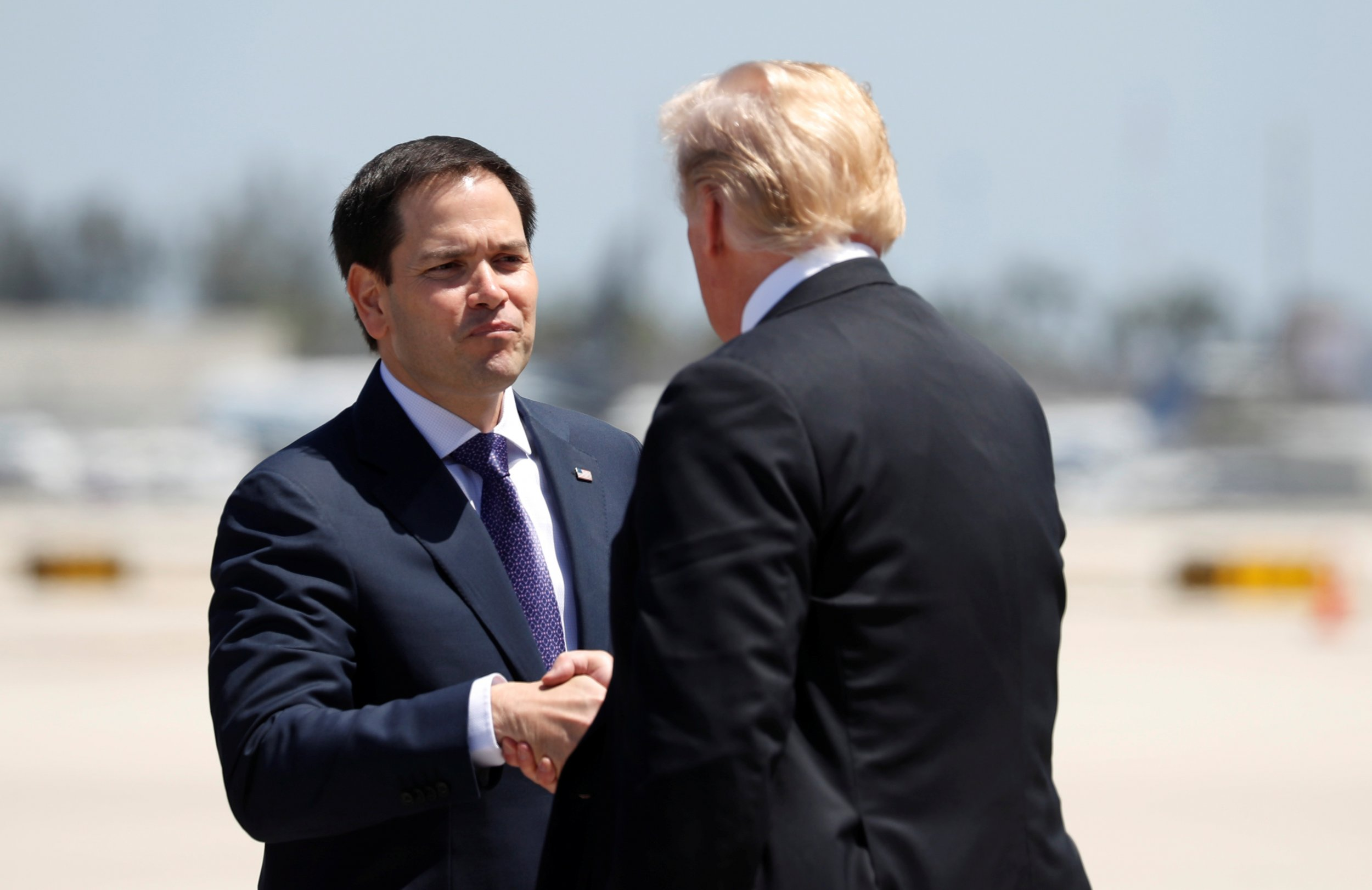 U.S. President Donald Trump is greeted by Senator Marco Rubio (R-FL) upon his arrival in Miami, Florida, U.S., April 16, 2018.