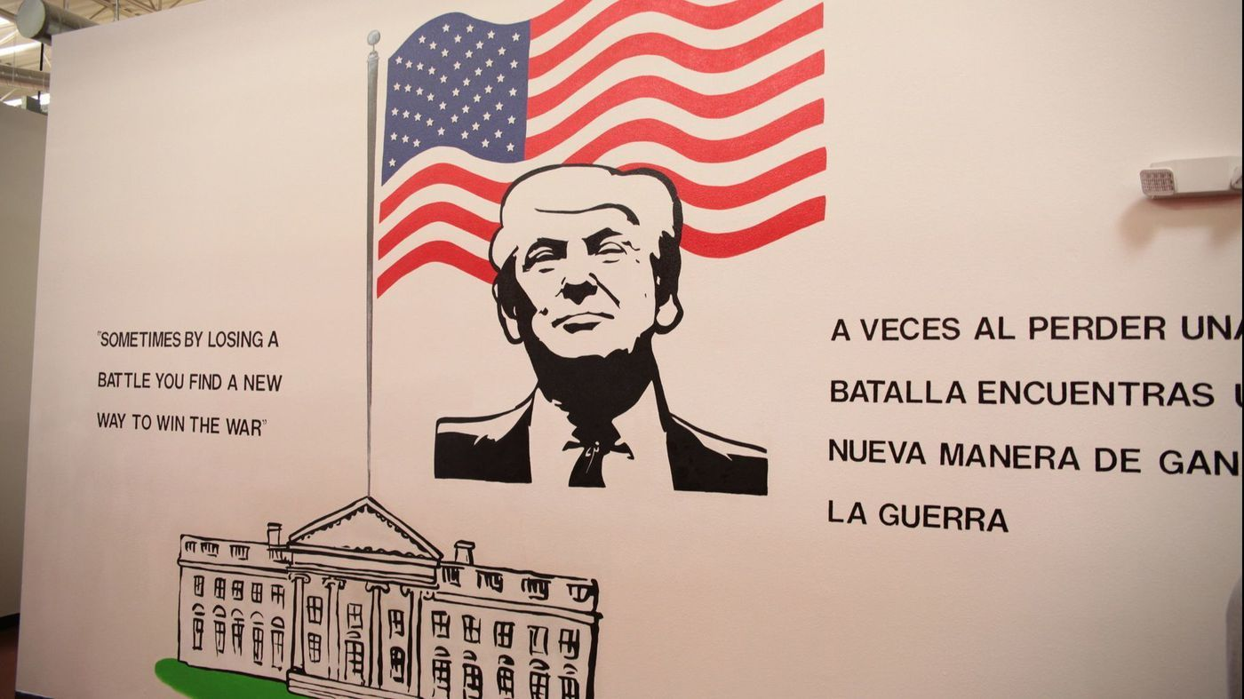 "A mural of Trump at a child immigration detention center reads ""sometimes losing a battle you find a new way to win the war,"" in Brownsville, Texas."