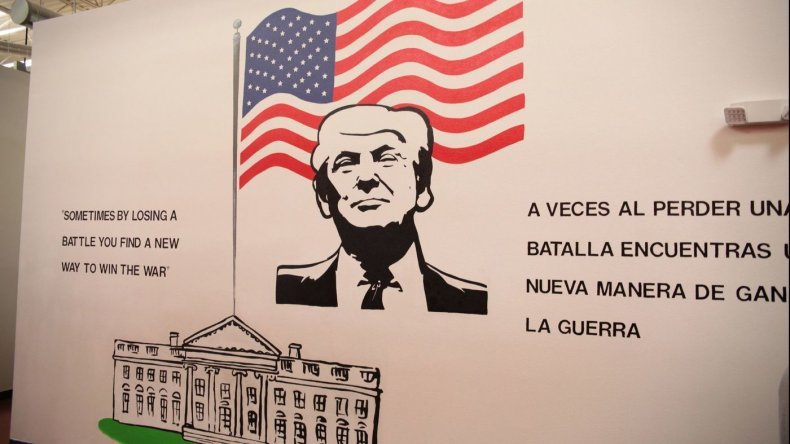 """A mural of Trump at a child immigration detention center reads """"sometimes losing a battle you find a new way to win the war,"""" in Brownsville, Texas."""