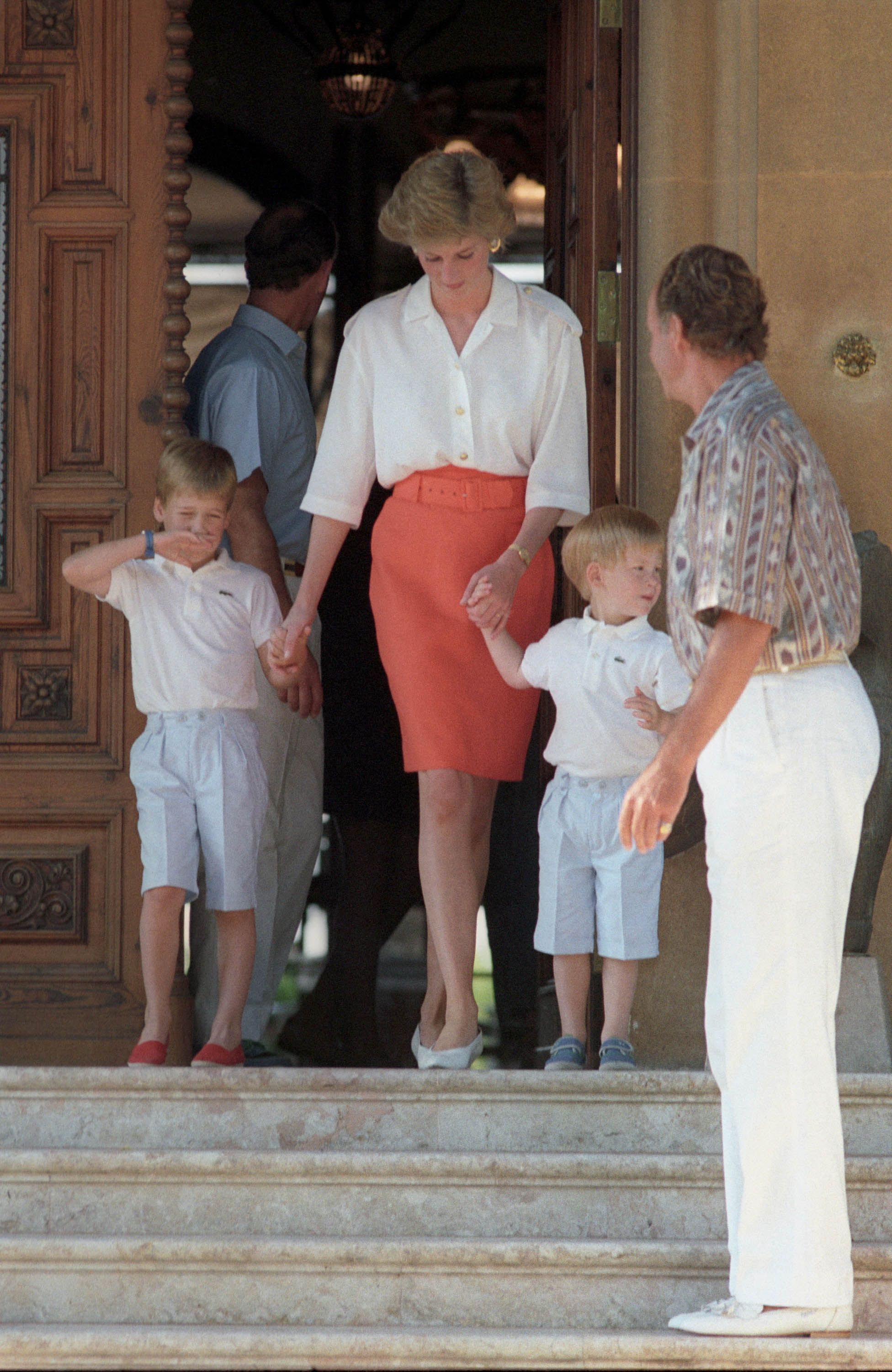 Princes Harry and William with Princess Diana and Prince Charles