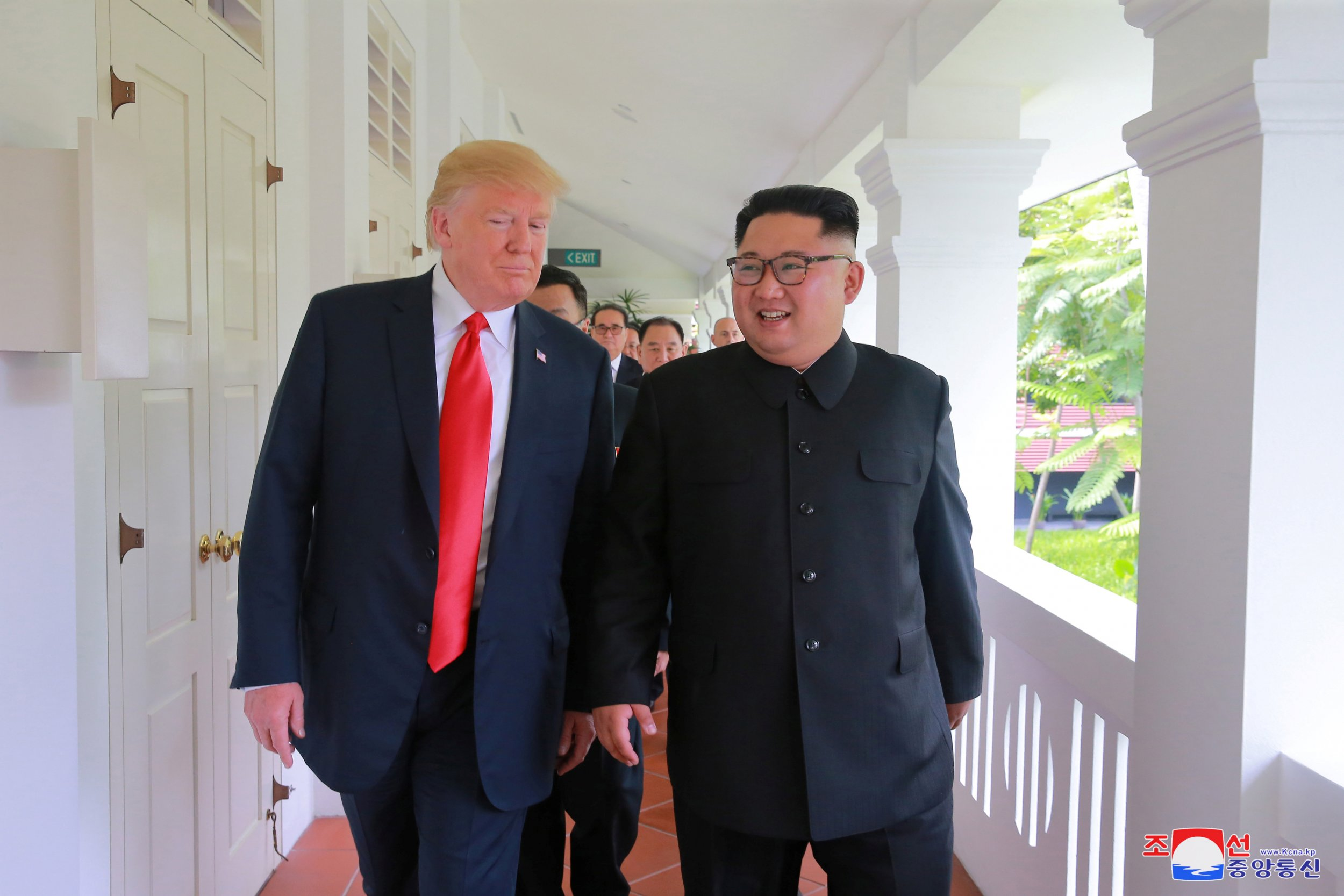 U.S. President Donald Trump walks with North Korean leader Kim Jong Un at the Capella Hotel on Sentosa island in Singapore in this picture released on June 12