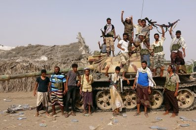 Tribal fighters loyal to the Yemeni government stand by a tank in al-Faza area near Hodeida, Yemen June 1, 2018. Picture taken June 1.