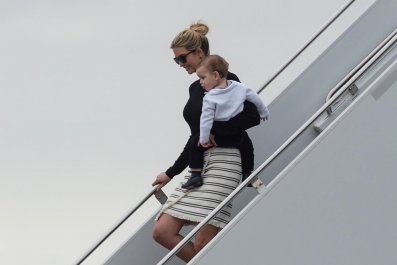 Ivanka Trump steps off Air Force One with her son Theodore upon arrival in West Palm Beach, Florida, on March 3, 2017.
