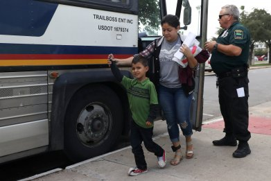 Bus carrying migrant detainees